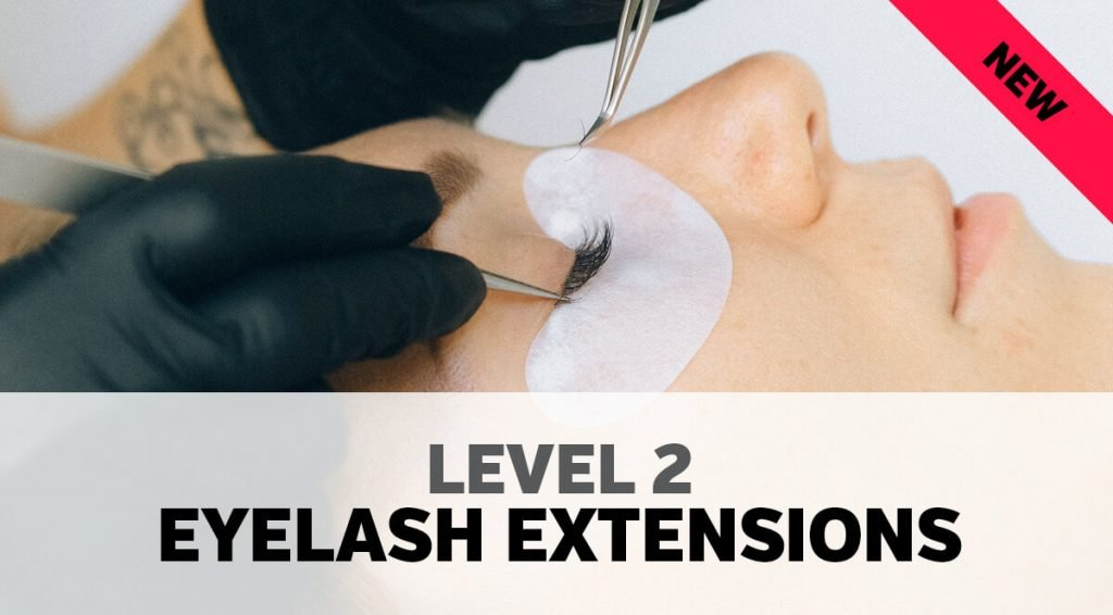 Woman having eyelashes applied in a lash studio