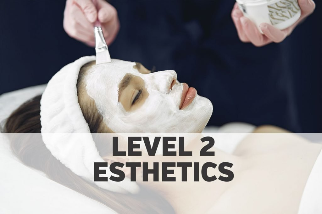 Woman in salon getting a facial with white masque