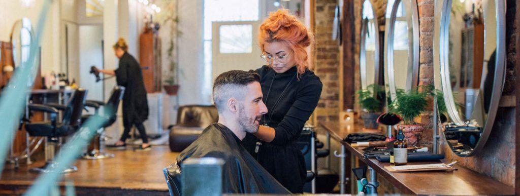 Woman barber in salon