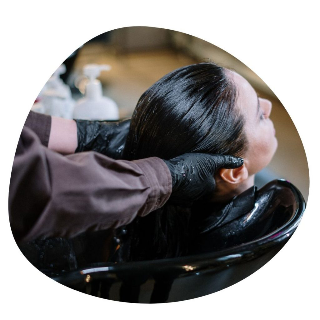 Woman having her hair washed in a salon