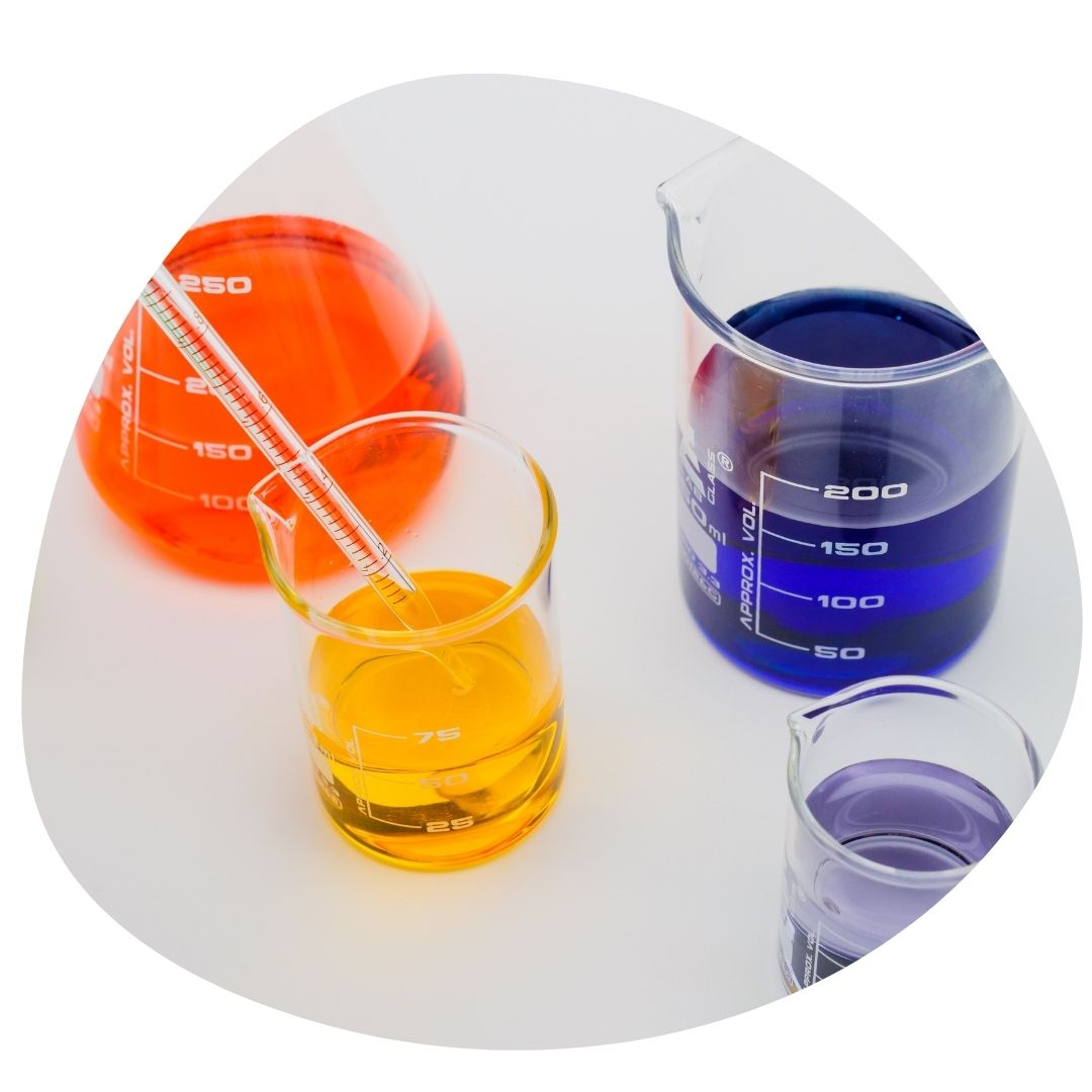 Beakers with coloured liquids